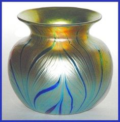"Lundberg Studios vase. Iridescent art nouveau mini-basket vase in Lundberg's ""Sunset zebra"" design."