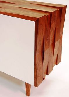 Cherry timber makes this carcass stand out, using different layers creates great texture. Clever use on simplicity.