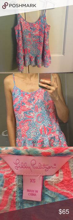 Lilly Pulitzer tank Waffle weave fabric with ruffles on bottom. Worn only once. Please no lowball offers. Looking to make most of my money back. Lilly Pulitzer Tops Tank Tops