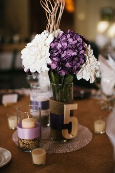 rustic purple centerpieces/ We could use some of the pale pink flowers instead, but I think cute with the big number