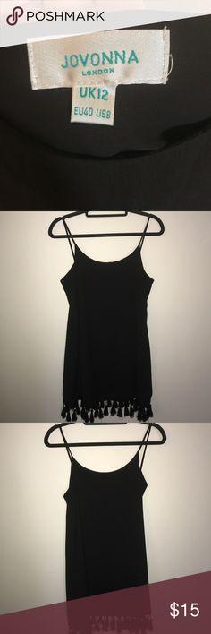 Black cocktail dress Staple for any closet. Strapped black cocktail dress. Purchased in London. Worn once. Jovonna Dresses Midi