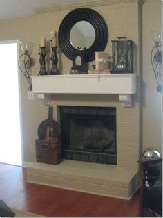 Mirror, candles, lantern, clock on a brick fireplace mantel dress up the entire room. I can't imagine not having a fireplace mantel. Painted Brick Fireplaces, Paint Fireplace, Fireplace Remodel, Fireplace Mantle, Fireplace Design, Fireplace Decorations, Painted Mantle, Home Living Room, Living Room Decor
