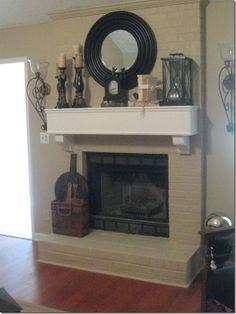 Fireplace decor? Mirror, candles, lantern, clock on a brick fireplace mantel