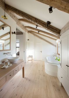 Very light, simple, country appeal. The Beams add a beautiful contrast to the off white walls.