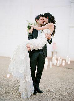 Gorgeous wedding. groom sweep bride off her feet and carry <3 www.dressmarketonline.com