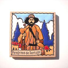 (http://www.spanishdoor.com/camino-de-santiago-pilgrim-tile-way-of-st-james-fridge-magnet-peregrino/)