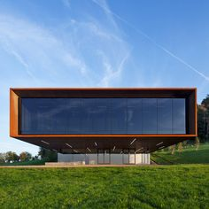 Gerrman architects Kada Wittfeld Architektur have completed this metal-bodied museum in Glauburg, Germany, that cantilevers out towards a historic Celtic burial mound. A large panoramic window to the end of this cantilever creates a viewpoint for visitors, facing the archeological site. Visitors can also access the roof, where an additional viewing platform is located. Internally a broad flight of steps leads from the entrance to the exhibition rooms.