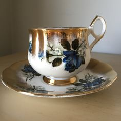 Sandringham Vintage Teacup and Saucer, Blue Rose Tea Cup and Saucer, Heavy Gold Trim English China by CupandOwl on Etsy