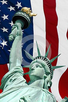 Statue of liberty close up on american flag background.