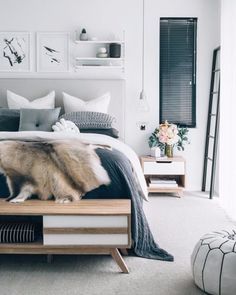 Bedroom furniture ideas - This room predominantly features brown, black and brown colors and the classy fur coat is the only element with all colors. www.homemagez.com