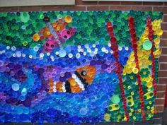 Bottle top art - an idea for olympic rings? Plastic Bottle Tops, Plastic Pop, Group Art Projects, School Art Projects, Bottle Top Art, Recycled Art, Stone Carving, Art Plastique, Under The Sea