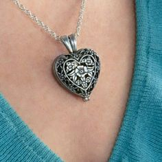 """❤️ Pet Memorial Urn Locket Heart Filigree Necklace $35  Follow me and never miss a jewelry! twitter.com/kimlyhudson  Engraved with sentiments """"Always in my Heart"""" and a Paw Print, this beautiful locket holds a lost pet's memory close to your heart. Inside, a tiny solid brass urn safely contains cremation ashes, offering special comfort. Silver-plated 1 1/2"""" long x 1"""" wide locket; 24"""" long chain with spring closure; 7/8"""" long urn with screw cap.  Please allow 4-6 days for your item to arrive…"""