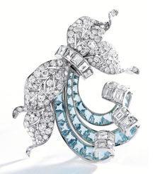 Of foliate design decorated with ribbon scrolls, set with round and single-cut diamonds weighing approximately 11.75 carats, accented by square-cut diamonds weighing approximately 9.70 carats, further set with 28 calibré-cut aquamarines,signed Flato, one aquamarine missing; circa 1940.