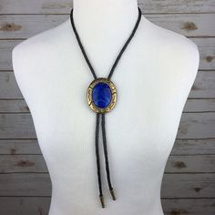 [Vintage] Leather Stone Bolo Tie Western Boho Chic The bolo tie is a popular boho trend at the moment. This vintage piece features braided leather with metal caps. Bright blue stone with etched gold tone setting. Adjustable slide. See last photo for styling ideas!  Condition: EUC. No flaws.  No Trades! No PayPal! Vintage Jewelry Necklaces