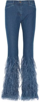 Michael Kors Collection Feather-trimmed mid-rise flared jeans . Michael Kors Collection's jeans were worn by model Freja Beha Erichsen as part of the first look on the Fall '16 runway. This mid-rise pair has an unexpected flourish at the flared hem - wispy ostrich feathers.