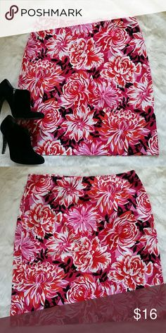 Floral skirt Vibrant floral skirt in excellent condition! Zips up the side with a button.  97% cotton and 3% spandex.  Measures 22.75 inches long. Andrea Viccaro Skirts