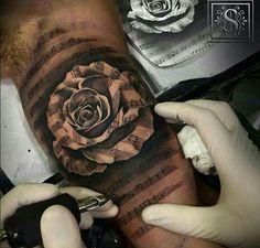 Rose music tattoo.