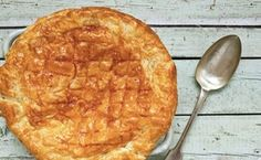 Rough puff—a simpler version of puff pastry—tops a savory beef and dark beer pie. / Photo by Shutterstock