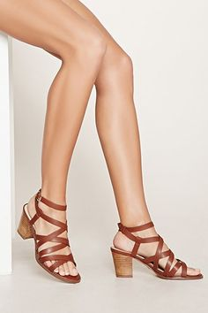 A pair of strappy faux leather sandals featuring a stacked block heel and wrap-around ankle straps with a buckled closure. Strappy Block Heel Sandals, Block Sandals, Socks And Sandals, Block Heel Shoes, Shoes Heels Wedges, Ankle Strap Heels, Ankle Straps, Shoes Sandals, Fancy Shoes