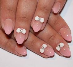 Pointed pink nail art with white 3d bows. #nails #nailart #manicure
