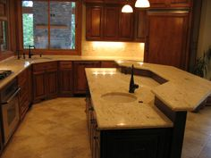 Colonial cream granite kitchen with cherry (?) cabinets
