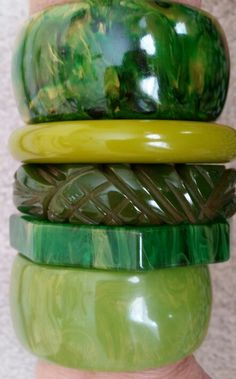 Vintage green bakelite bracelets in different shades.