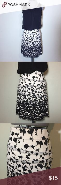 """Listing: WHBM Layered Ruffle Pencil Skirt White House Black Market Layered Ruffle Pencil Skirt. In great condition. Size 6 measures flat: 16"""" across top, 19"""" across hips, 21"""" long. 97% cotton, 2% spandex. Fully lined, 100% poly, side zip closure. 424/100/042817 White House Black Market Skirts Pencil"""