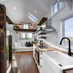 Tiny Home - Cozy and Bright! - Tiny House for Rent in Delta, British Columbia Kitchen complete with herringbone countertop, ceramic apron front sink, Moen Faucet! Propane oven and cooktop, and hood fan. Tiny Houses For Rent, Tiny House Plans, Tiny House On Wheels, Small Houses For Sale, Tiny Houses Canada, Little Houses, Tiny House Company, Tiny House Listings, Tiny Spaces