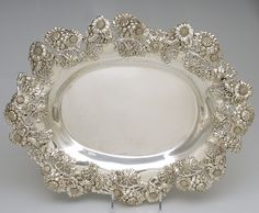 Antique sterling silver platter with ornate floral trim from Dominick & Haff.