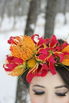 Fuchsia gloriosa lilies and bright orange pincushion proteas gave the bride's third floral crown a tropical edge.  Photo by Hope Kauffman Photography  Design & Styling: Goldfinch Events & Design   Flowers: Mum's Flowers