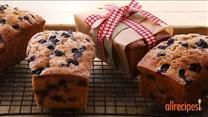 Blueberries and zucchini baked up into delicious little summertime bread loaves!