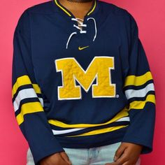 208aa02258 UofM hockey jersey. Size Men Large (fits like medium. Created by Nike Jersey