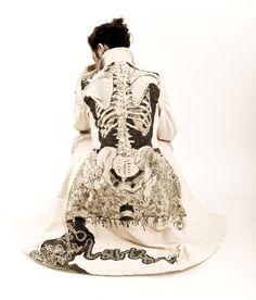 Coat by Leeds-based illustrator & designer Jamie Avis. Hand drawn with black ink he combined his drawing skill with a love of fashion by rendering a scale-size skeleton onto the fabric of this ladies jacket.