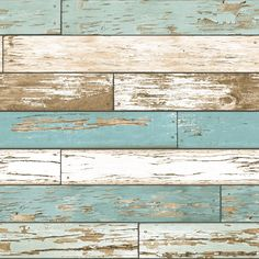 A Street Prints Scrap Wood Wallpaper - Weathered wooden planks with a flaking cream and teal paint effect.
