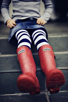 red rain boots and striped tights