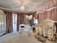 Oh my! That is a fancy nursery! I'd be concerned with all the fabric, is that really practical. Of course, it looks as though they can afford to be impractical!