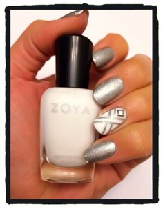 X marks the spot with Zoya Purity and a little bling. Orly holographic nail polish Prisma Gloss Silver, nail tape design, and nail stud.