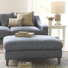 The Legsie footstool leaves feet wanting more with its comfy cushion top, cool curves & lovely weathered oak legs, plus it's available in over 60 fab. New Living Room, Living Room Decor, Upholstered Footstool, Thatched House, Blue Colour Palette, Weathered Oak, Modern Country, Ideal Home, Love Seat
