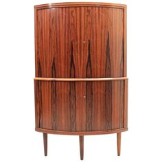 Danish, Mid-Century Modern Rosewood Corner Cabinet, circa 1960   From a unique collection of antique and modern corner cupboards at https://www.1stdibs.com/furniture/storage-case-pieces/corner-cupboards/