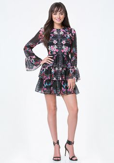 All dolled up. Totally charming dress in a bebe-exclusive print, getting attention with a flirty ruffle-tiered skirt and of-the-moment trumpet sleeves. Hidden back hook-and-eye and zip closure. Partially lined.