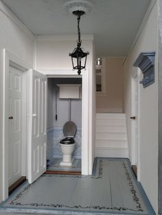 Hall with toilet and stairs