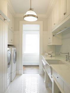 Clean, white bright laundry room Laundry Room Ideas. Interior Designer: Brooks Falotico