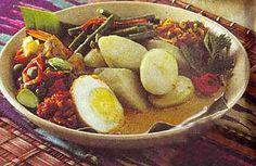 Lontong Medan, sliced rice cakes with variety of topping sauce from Medan (North Sumatra)
