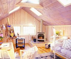 The Attic. No longer a musty and dreary bat hideout, this attic serves as a light and airy spare bedroom, living area, and craft room.