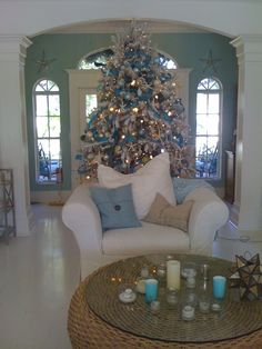beach house Christmas. like the idea of the tree in the huge entry - very nice!