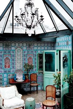 This interior is so elegant in its bohemian Moroccan style. Love the deep blue and turquoise patterns.