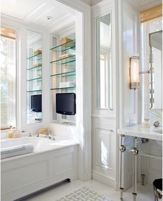The vanity niche, tall cabinetry, mirrors - love via Design Chic, Gil Schafer