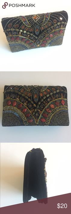 Beaded Pyramid Collection Clutch Beaded black clutch bag by pyramid collection . Great condition no stains or flaws , velvety feel of the black material . No trades pyramid collection Bags Clutches & Wristlets