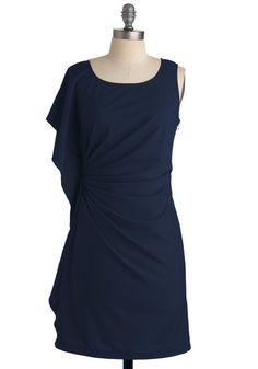 This reminds me of a dress I saw on Newbury Street, though it was in a vibrant salmon color. Looks great in navy, too.