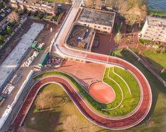 Utrecht bike bridge doubles as roof for a school - Curbedclockmenumore-arrow : The creative bridge-builders at Next Architects have done it again